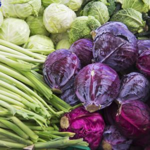 green and purple cabbage, leek on market for sale