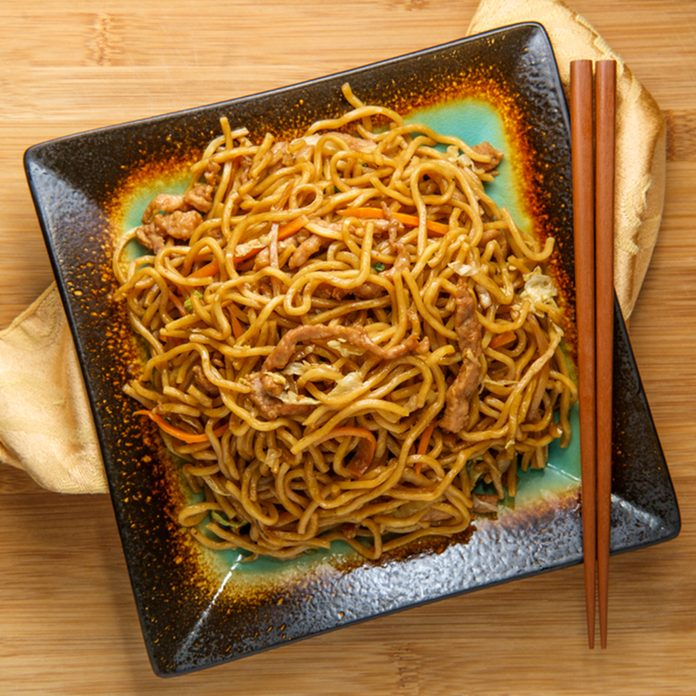 Eating Chinese pork lo mein noodles with chopsticks; Shutterstock ID 1212481024; Job (TFH, TOH, RD, BNB, CWM, CM): TOH