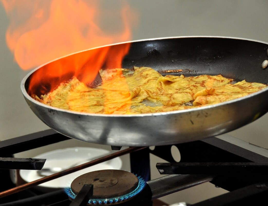 French crepes made in oven with fire over them. Flamb�© style.