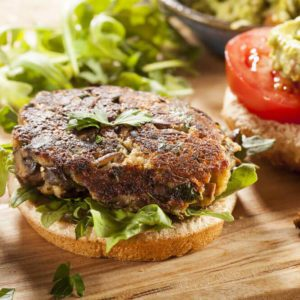 Homemade Organic Vegetarian Mushroom Burger with tomato and guacamole