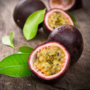 Passion fruits on wooden background