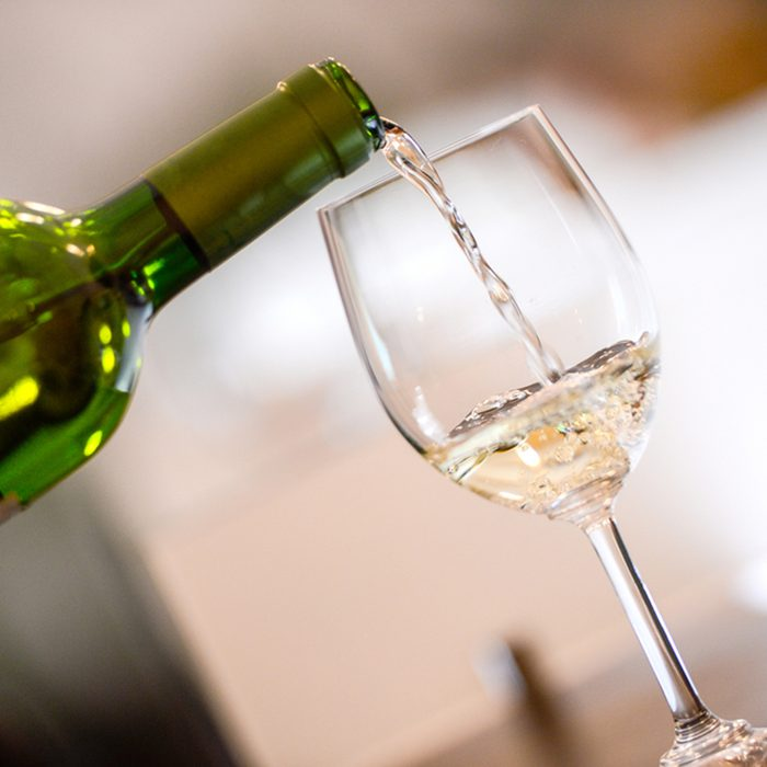 Tasting-White wine pour in a glass; Shutterstock ID 195727904; Job (TFH, TOH, RD, BNB, CWM, CM): TOH
