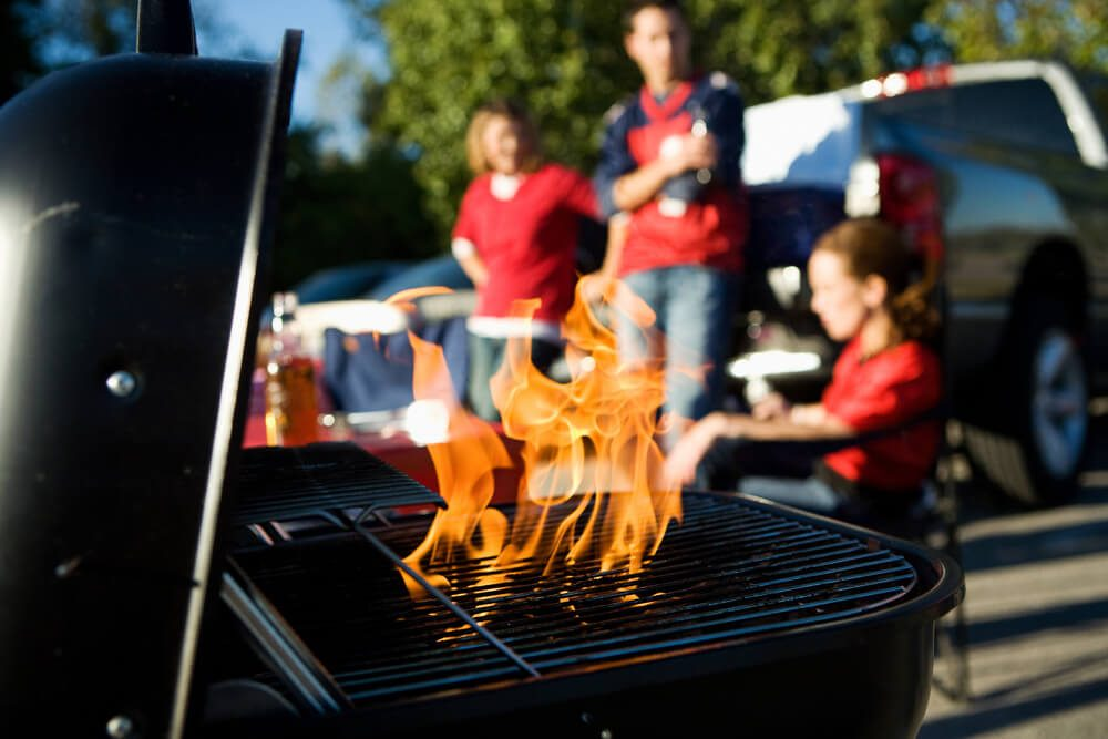 Tailgate: Charcoal Burning In Grill During Tailgating Party