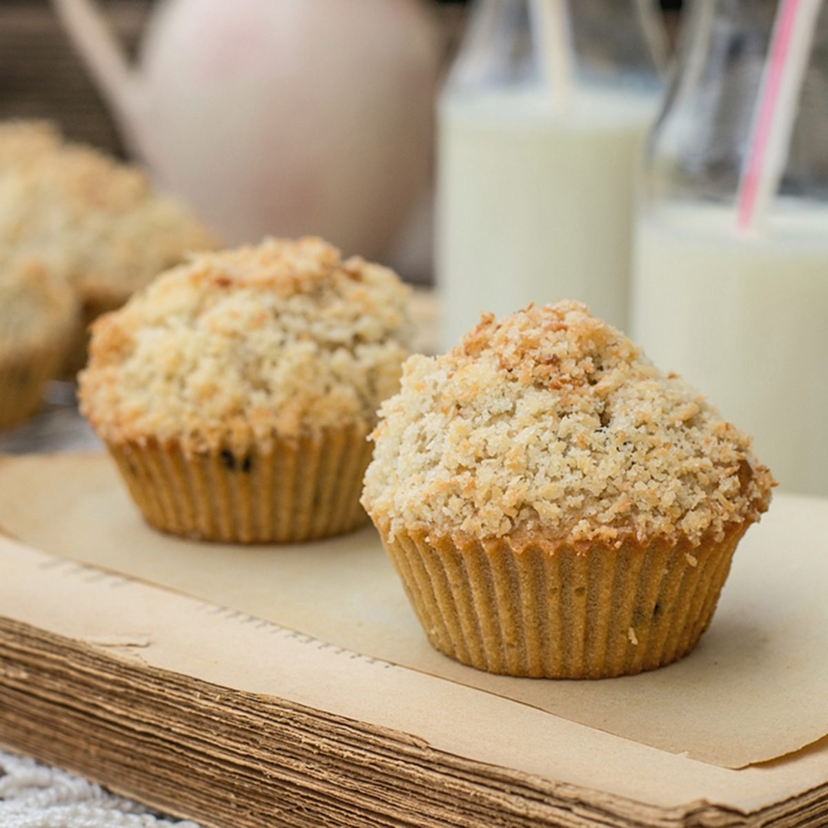 Chocolate chip muffins with coconut streusel on top. Vignetting and rustic style; Shutterstock ID 240410410; Job (TFH, TOH, RD, BNB, CWM, CM): TOH
