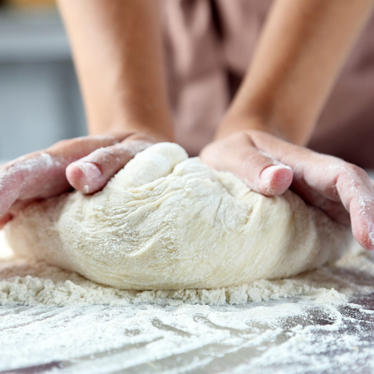 Making dough by female hands at bakery; Shutterstock ID 321264986