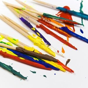 Toothpicks covered in many colors of paint.