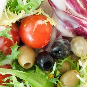 macro background of fresh mediterranean salad with dressing yogurt