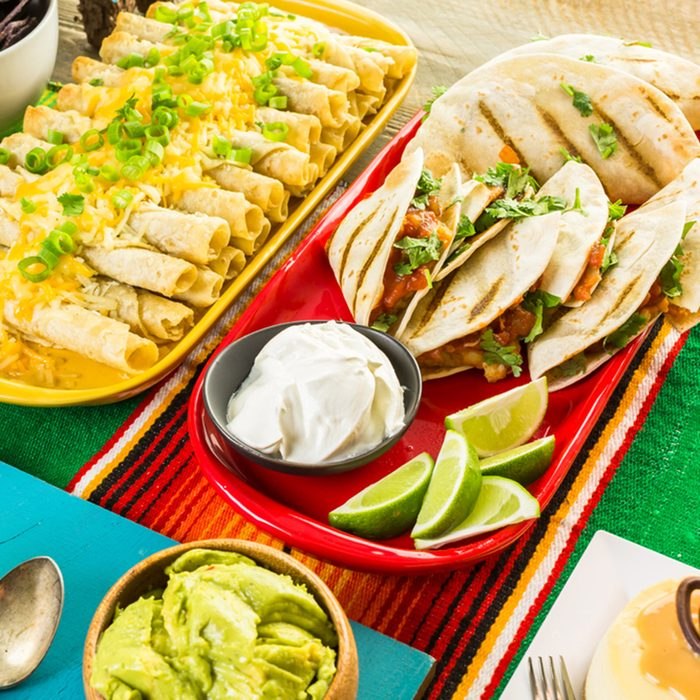 Fiesta party buffet table with traditional Mexican food.; Shutterstock ID 423661501