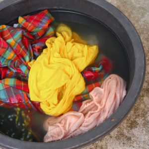 soak dirty clothes in the basin black for clean Thailand washing clothes style ancient with detergent
