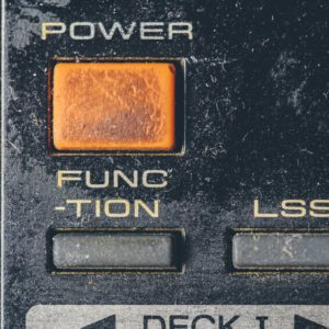 Rubber buttons on an old retro electronic remote control; dusty; old; remote