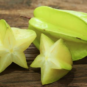 Star fruits on wooden table.