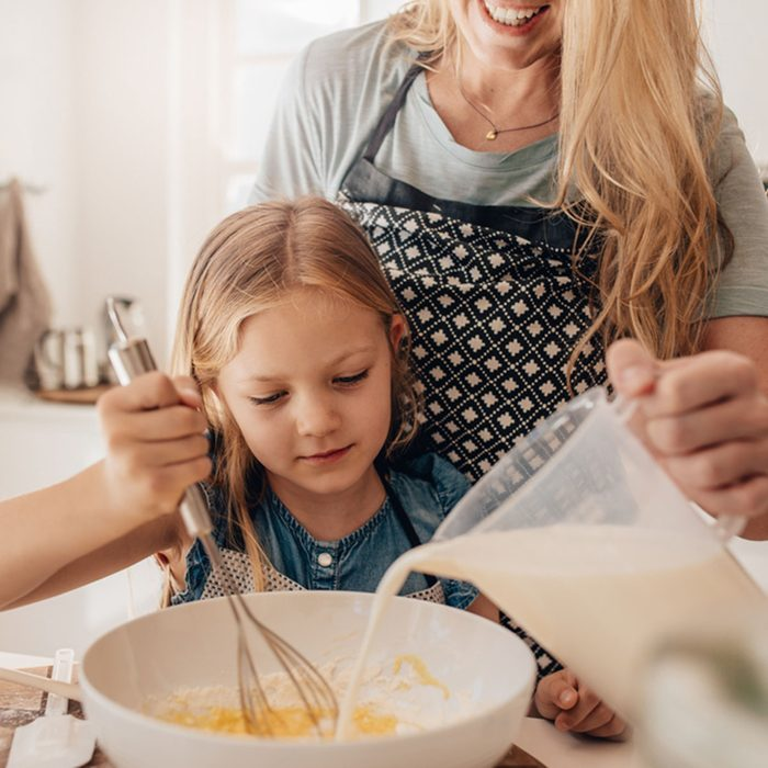 Cute little girl and her mother mixing batter in the bowl. Mother pouring milk with daughter whisking the batter.; Shutterstock ID 547492798; Job (TFH, TOH, RD, BNB, CWM, CM): Taste of Home