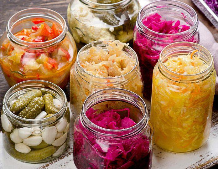 Fermented vegetables in jars. Vegetarian food concept