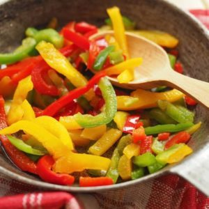 Three color bell pepper strips in a pot