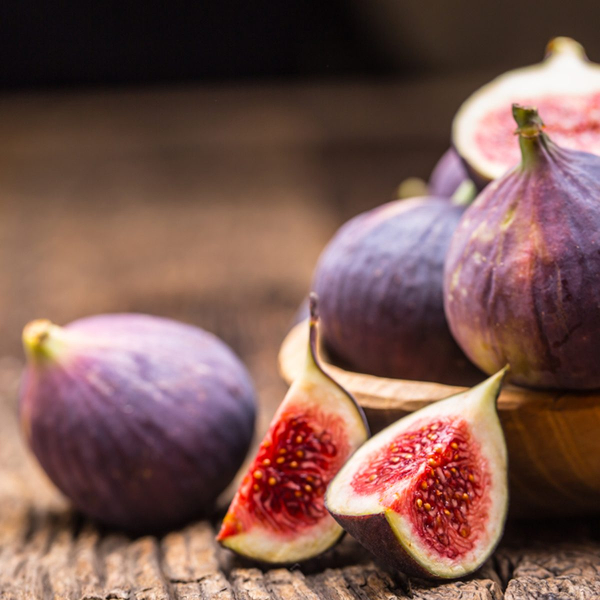 A few figs in a bowl on an old wooden background.; Shutterstock ID 743841358; Job (TFH, TOH, RD, BNB, CWM, CM): TOH