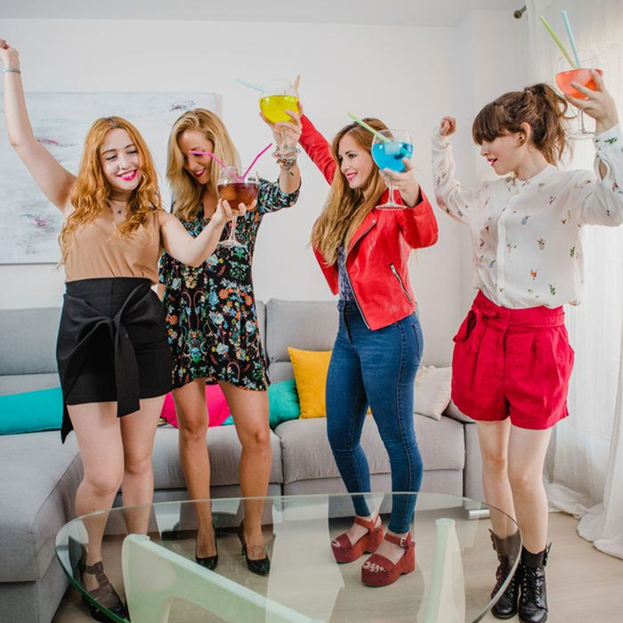 friendship, people and pajama party concept - happy friends or teenage girls having fun, dancing and jumping at home; Shutterstock ID 752420494