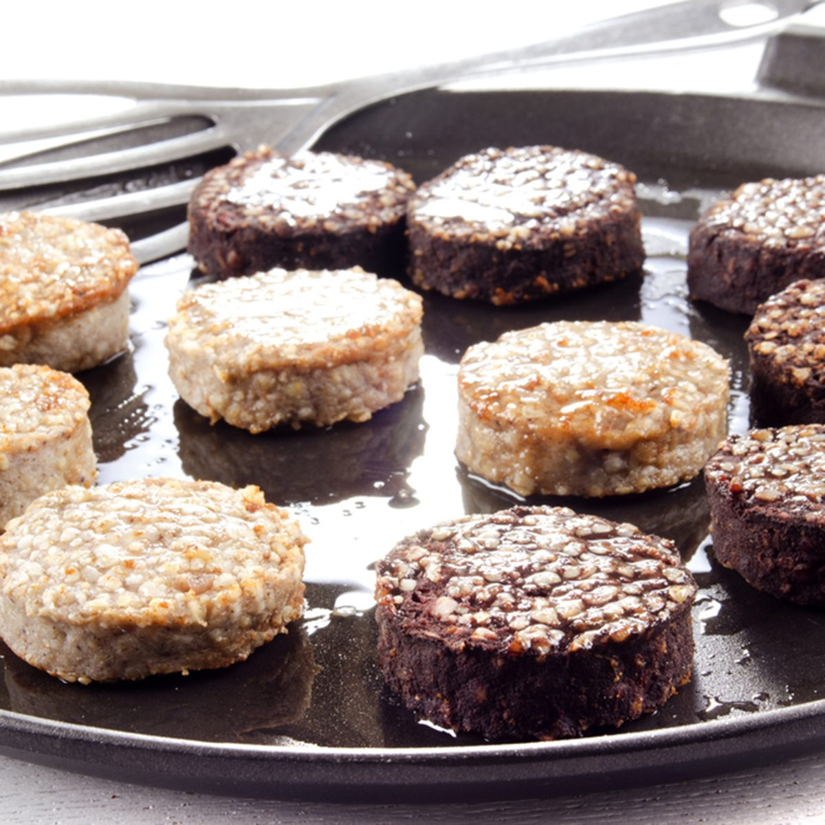 white and black pudding on a pan; Shutterstock ID 149291570