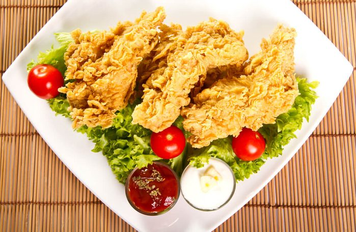 Fried chicken breast on a plate