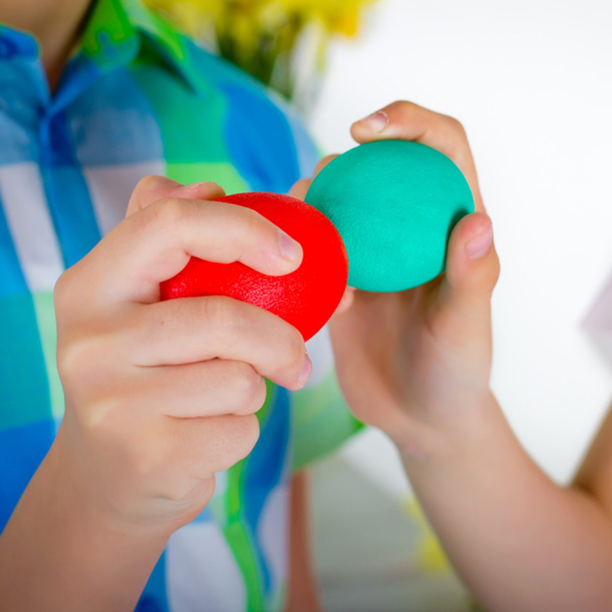 The boy and girl are playing colored Easter eggs; Shutterstock ID 372831721