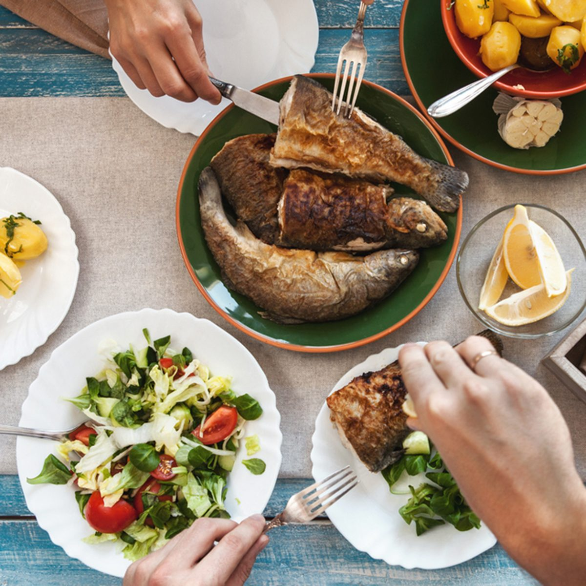 Dinner with fried fish, potatoes and fresh salad; Shutterstock ID 400166998
