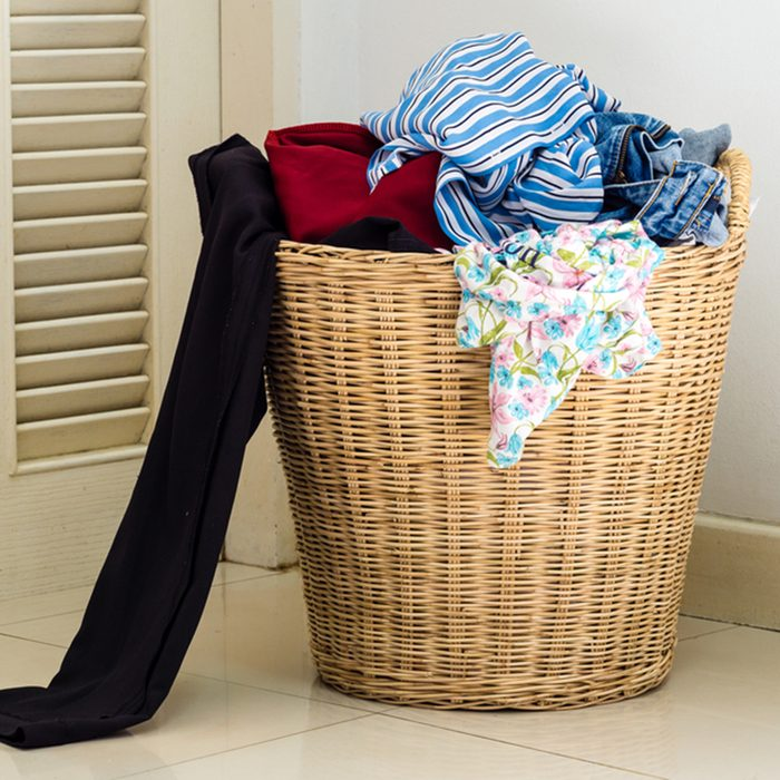Pile of dirty clothes in a washing basket; Shutterstock ID 410632486