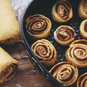 Homemade cinnamon rolls on the wooden background