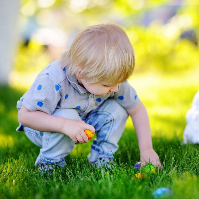 Little boy hunting for easter egg in spring garden on Easter day. Cute little child with traditional bunny celebrating feast; Shutterstock ID 516736762