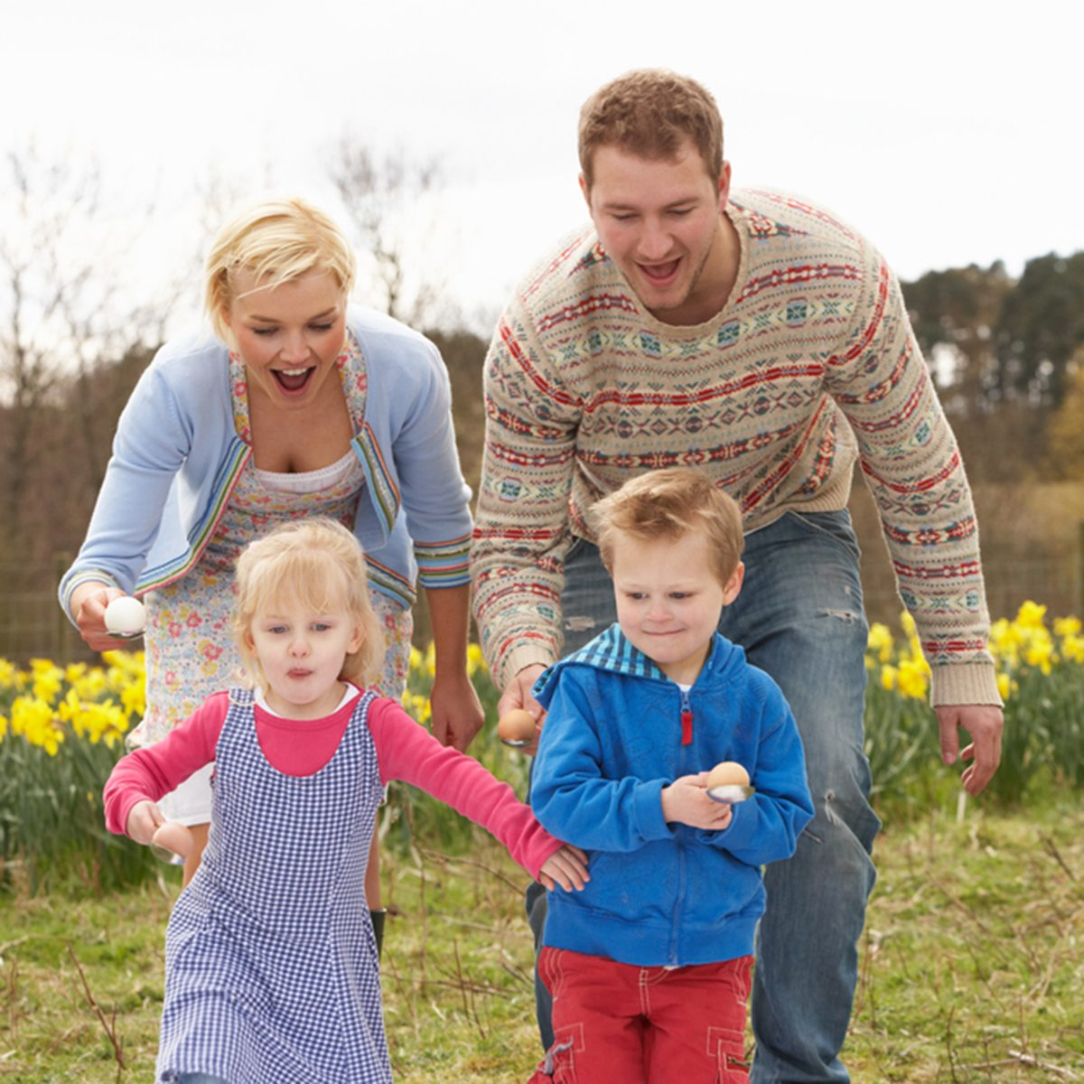 Family Having Egg And Spoon Race; Shutterstock ID 60510538