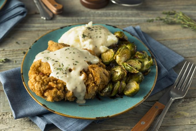 Homemade Country Fried Steak with Gravy and Potatoes