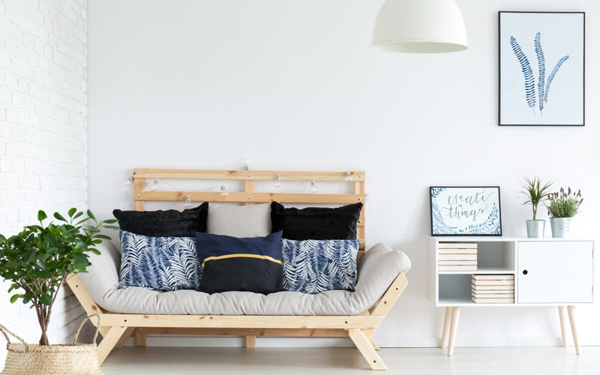 Trendy white lagom living room with simple wooden sofa