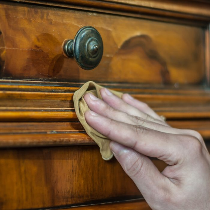 Furniture restoration. Hand cleaning a wood furniture with a cloth; Shutterstock ID 766459951; Job (TFH, TOH, RD, BNB, CWM, CM): TOH