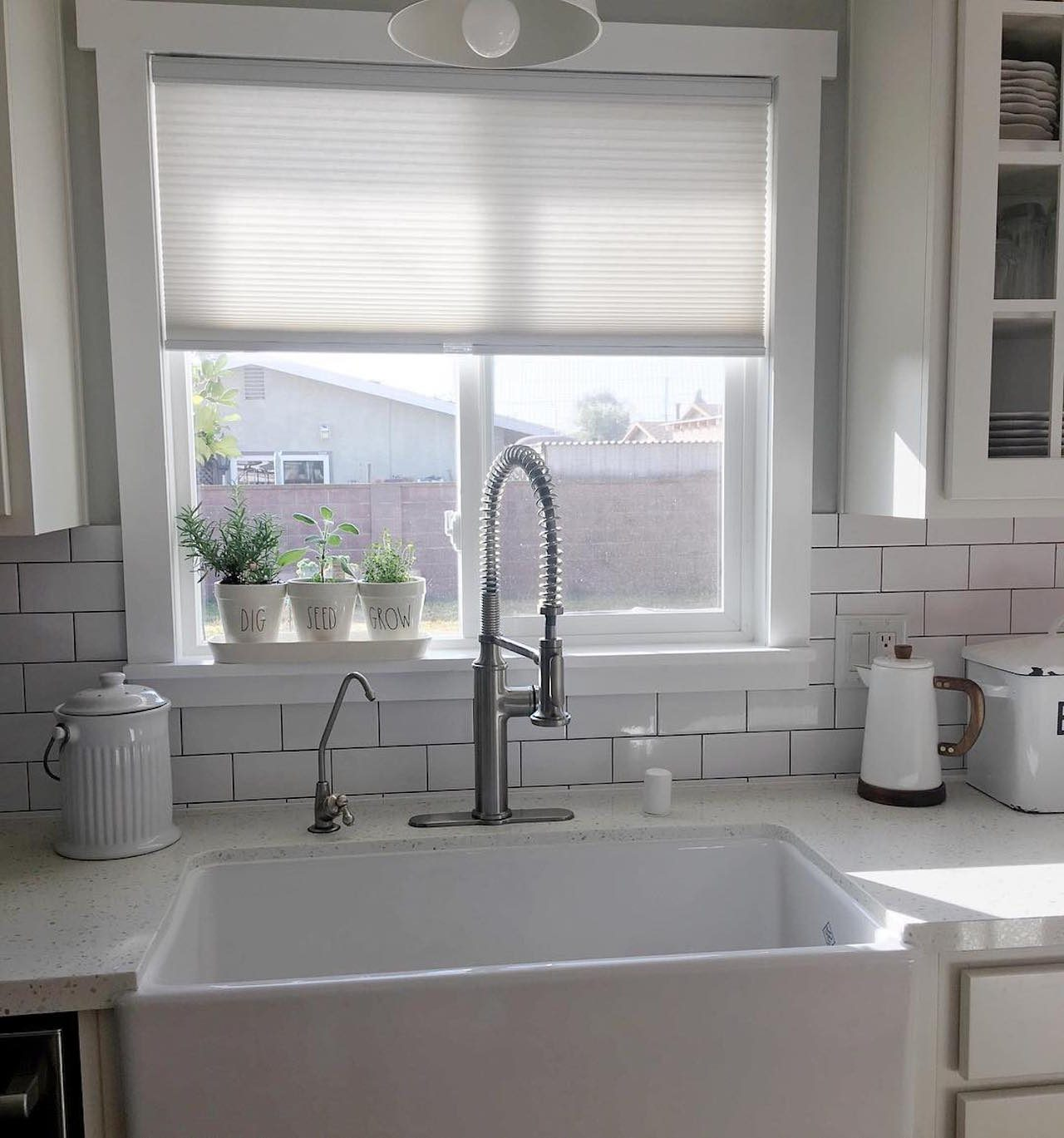 White tile backsplash in modern kitchen
