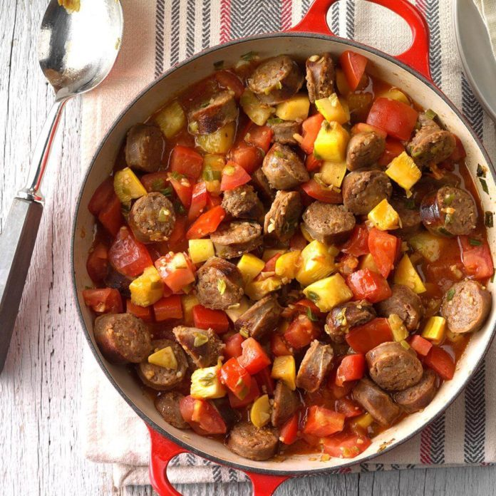 A skillet filled with sausages and vegetables for Oktoberfest