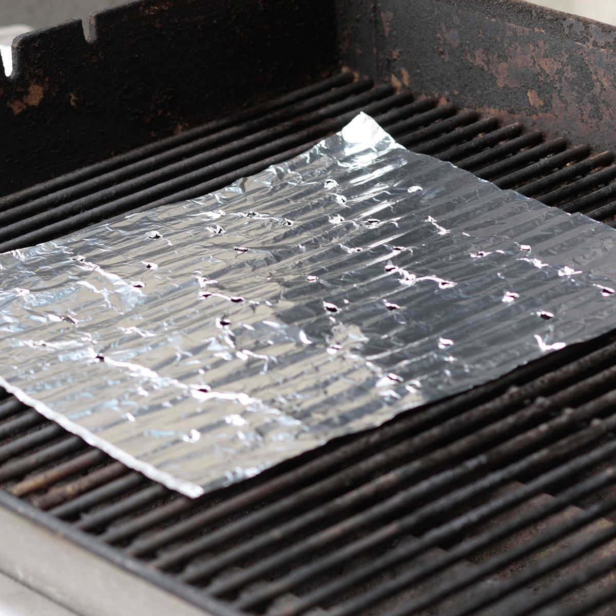 Foil sheet on a grill