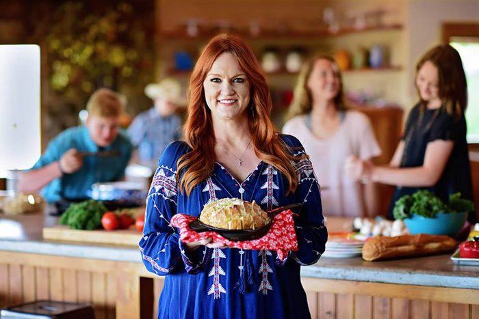 Pioneer woman holding dish