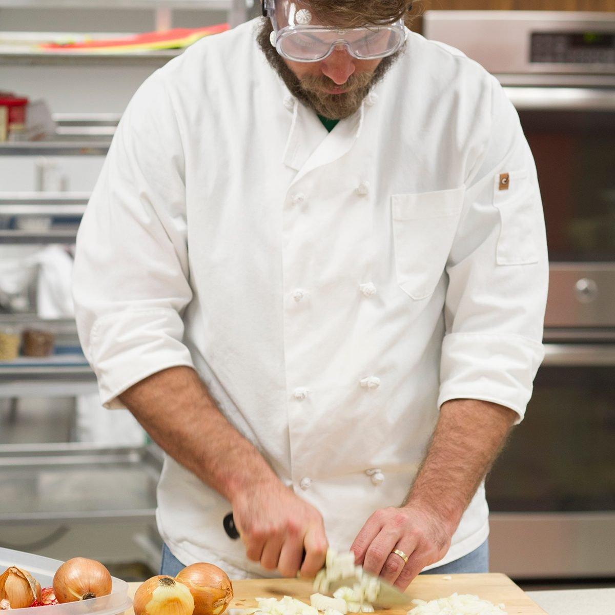 Chef cutting onions