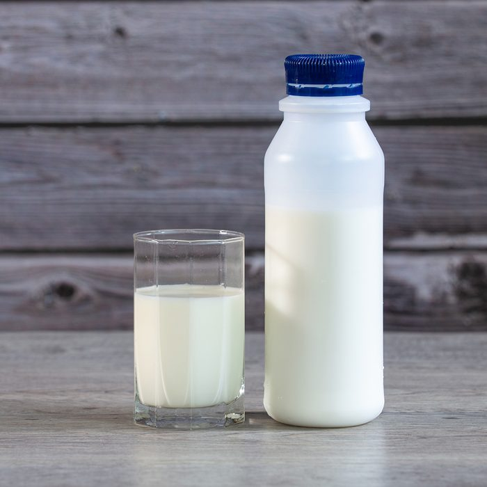 Milk in bottle and Glass of milk on Table