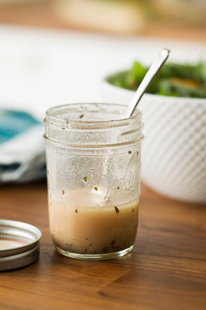 Simple vinaigrette in Mason jar.