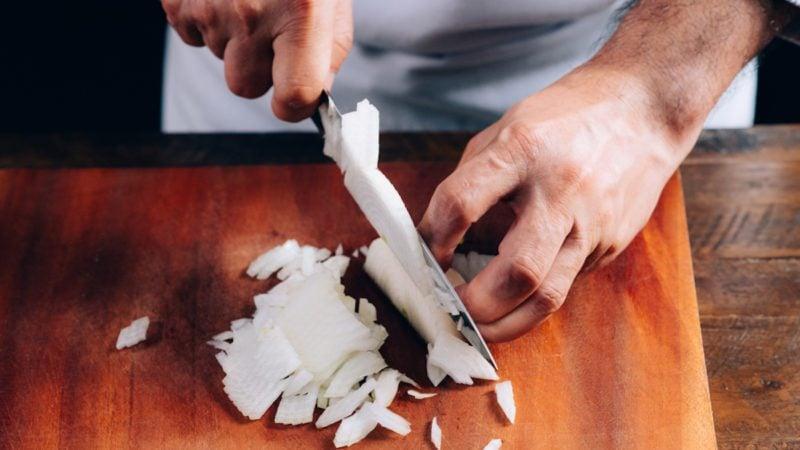 Chef chopping an onion