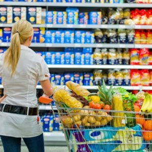 a woman is overwhelmed with the wide range in the supermarket when shopping