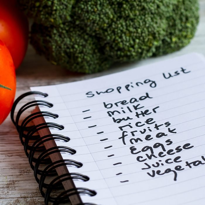 Preparing the shopping list before going to buy the groceries. ; Shutterstock ID 221603185