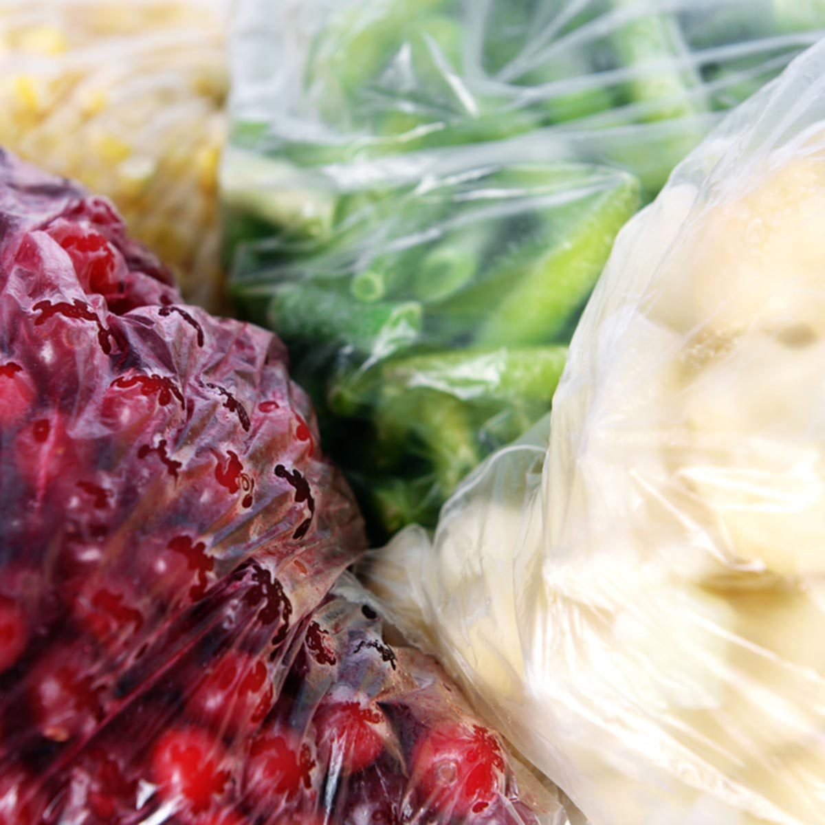 Frozen berries and vegetables in bags close up; Shutterstock ID 284295449