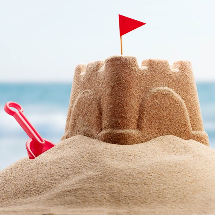Holiday concept with sandcastle on the seaside