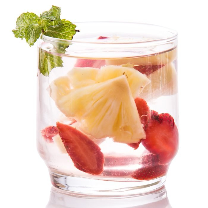 Summer fresh fruit Flavored infused water mix of strawberry and pineapple isolated over white background