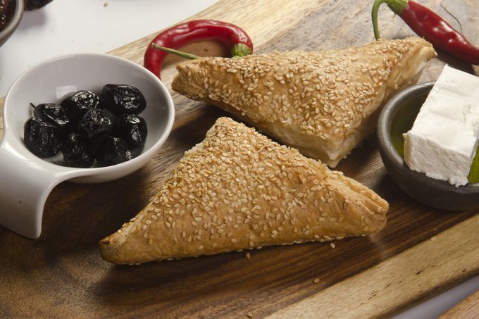Borek (Also Burek) a Turkish pastry filled with cheese or potato or mushroom with black olives