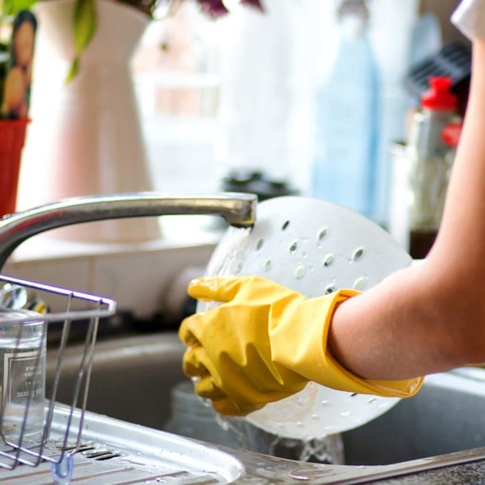 Woman washing dishes in the kitchen.