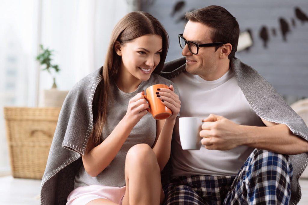 Cheerful young couple enjoying coffee
