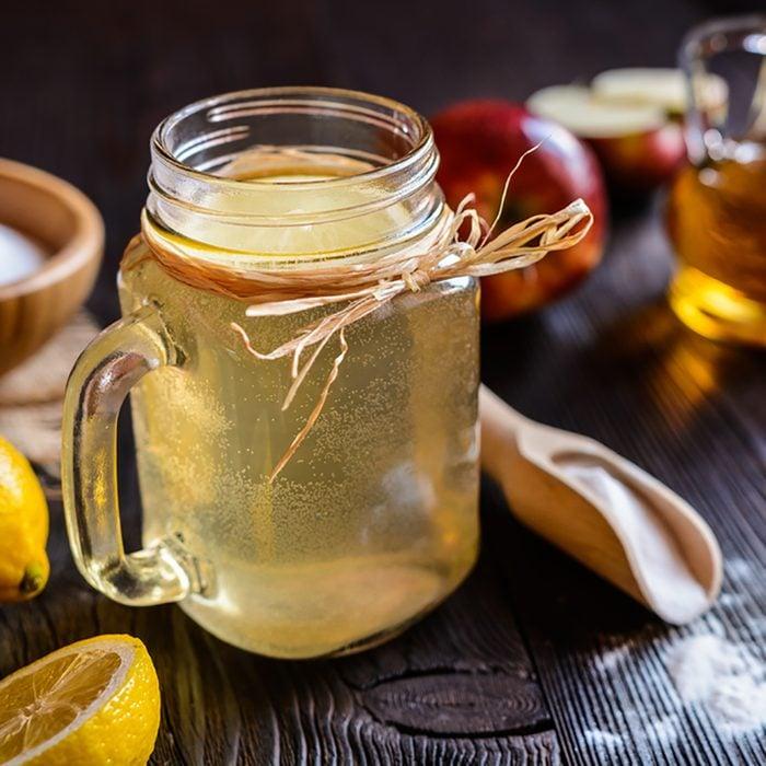 Detox drink made of water, apple cider vinegar, lemon juice and baking soda; Shutterstock ID 580918609