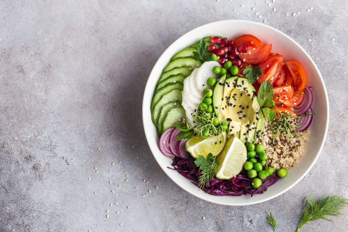 Healthy Vegan Lunch Bowl. Avocado, Quinoa, Tomato, Cucumber, Red Cabbage,