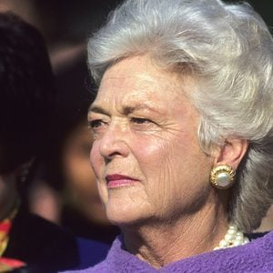 First Lady Barbara Bush holds her hand over her heart as the American Athem is played at the White House during official State visit ceremony on the South Lawn. Political figures, America